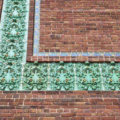 Figure 7 Front facade - oriental bricks, glazed terra-cotta, and mosaic band